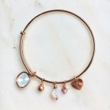 Rose gold crystal charm bangle bracelet in white opal