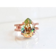 Iridescent rose gold ring with pear shape crystal