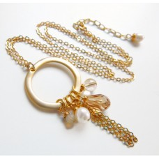 Gold crystal charm tassel necklace